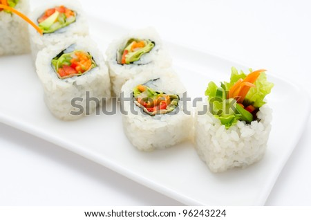 vegetarian sushi rolls with avocado and vegetables - stock photo
