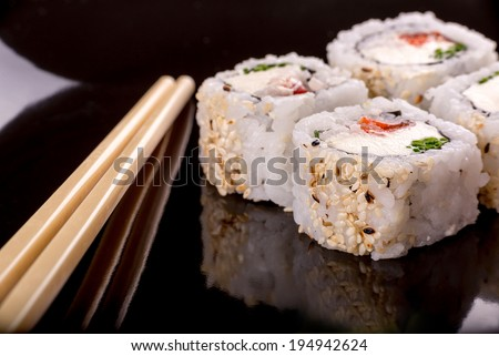 Vegetarian sushi with chop sticks on left