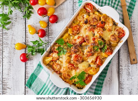 Vegetarian Vegetable casserole with zucchini, mushrooms and cherry tomatoes. Top view - stock photo