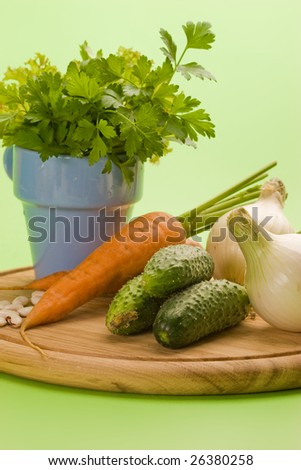 vegeterian food, fresh vegetables: onion, carrot, cucumber and parsley