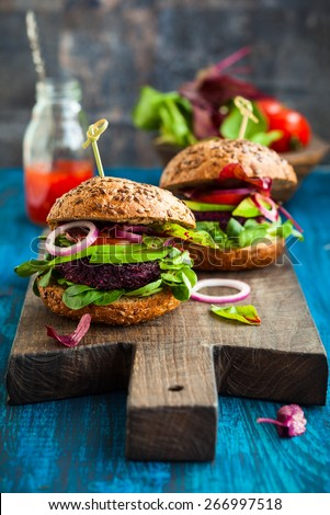 Veggie beet and quinoa burger with avocado - stock photo