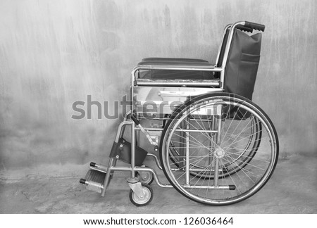 Vehicle for handicapped on concrete wall background, wheelchair during walk in park, car road accident and health , hospital