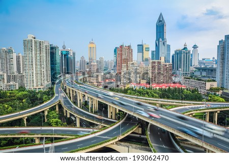 vehicle motion blur on the elevated road  junction  with modern city skyline  - stock photo