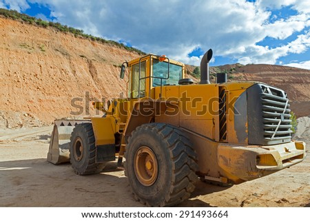 Vehicle rear side view machine shovel excavator and loader, clearing In a gravel pit  - stock photo