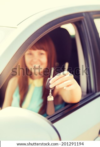 vehicle, rental, automotive concept - happy woman holding car key - stock photo