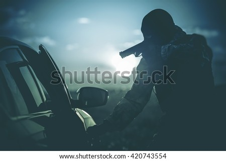 Vehicles Check Point Made by Police. Policeman in a Mask Points Gun at Suspicious Car Passenger. Anti Terrorism Check Point. Military Check Point. - stock photo