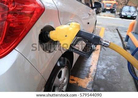 Vehicles with gasoline at gas stations