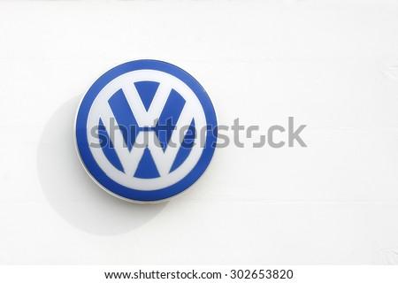 Vejle, Denmark - July 4, 2015: Volkswagen logo on a facade. Volkswagen is a German car manufacturer headquartered in Wolfsburg, Germany.  - stock photo