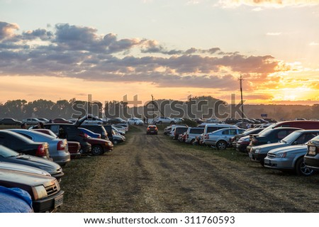 VELIKI SOROCHINTSI, UKRAINE - 22 AUGUST, 2015: National Sorochintsy Fair-national scale, industrial and agricultural exhibition. Temporary parking.