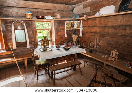 VELIKY NOVGOROD - JULY 23, 2014: Interior of old rural wooden house in the museum of wooden architecture Vitoslavlitsy. Wooden buildings dating from the 14th to the 19th century - stock photo