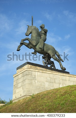 VELIKY NOVGOROD, RUSSIA - AUGUST 04, 2014: Red Army soldier on horseback trampling a swastika. Detail of the Monument to Victory in Novgorod