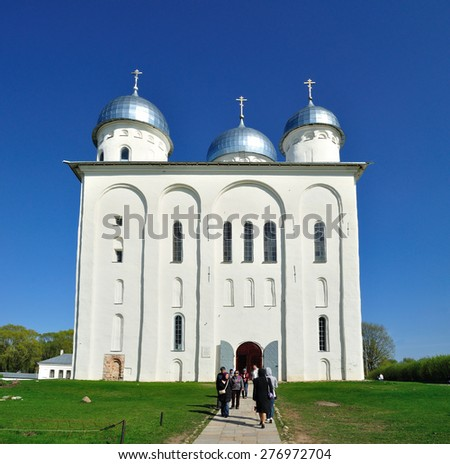 VELIKY NOVGOROD, RUSSIA - MAY 10. 2015. Parishioners at St. George's Cathedral in Russian orthodox Yuriev Monastery in spring sunny day - stock photo