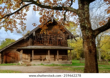 VELIKY NOVGOROD, RUSSIA - OCTOBER 6, 2012 .  Autumn landscape with the old wooden  peasant hut  at the Museum of Wooden Architecture Vitoslavlitsy (soft focus processing) - stock photo