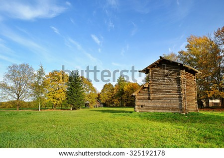 VELIKY NOVGOROD, RUSSIA - OCTOBER 4, 2015. Old wooden farm building at the famous Museum of Wooden Architecture Vitoslavlitsy  - stock photo