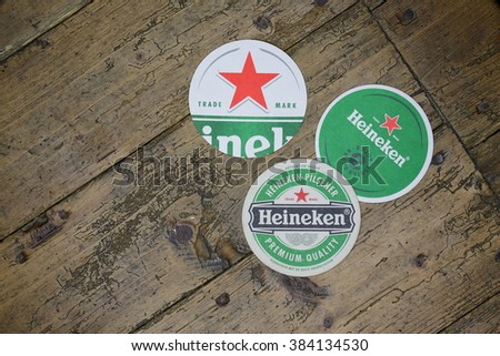 VELKE KARLOVICE, CZECH -July 10,2015: Berrmats from Heineken Lager Beer in vintage background , it was first brewed by Gerard Adriaan Heineken in 1873