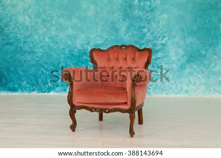 Velvet chair in an empty room