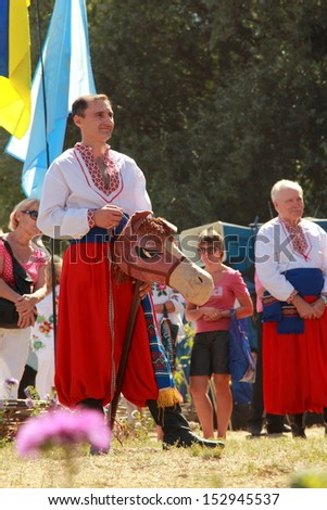 VELYKI SOROCHINTSY, UKRAINE - AUGUST 24: Participants of National Sorochyntsi Fair is a large traditional Ukrainian fair, August 24, 2013 in the village of Velyki Sorochyntsi of Poltava state, Ukraine