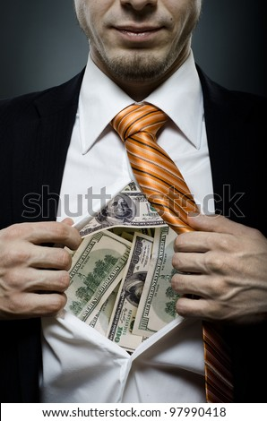 venality businessman or banker  in black costume throw open one's shirt packed heap dollars - stock photo