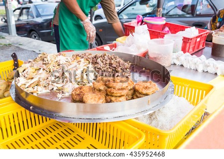 Vendor selling cuisine at street bazaar in Malaysia catered for iftar during Muslim fasting month of Ramadan - stock photo