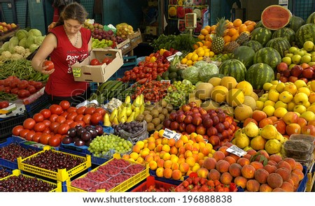 Vendor sells vegetables at the market in Sofia, Bulgaria Jun 16, 2008
