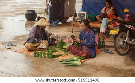 Vendors brought prepared flowers for sale to Tourists pray in temple Ing Hang.Savannakhet,Laos,August 2016