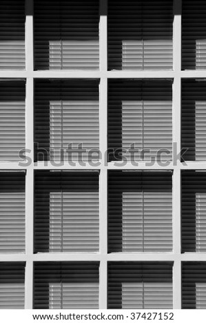 venetian blinds behind white wooden window frames - stock photo
