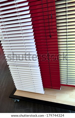 Venetian blinds in a warehouse - stock photo