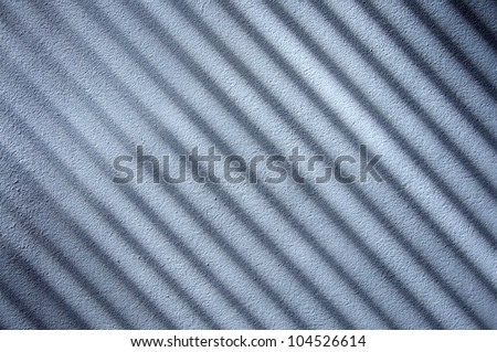 venetian blinds shadows on the wall.  - stock photo