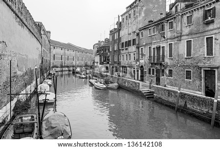 Venetian canal in the bad weather - Venice, Italy (black and white)