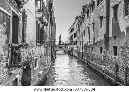 Venetian canal Rio de la Pleto. Old walls with balcony and architecturical elements. Venice, Veneto, Italy. Black and white photography. - stock photo