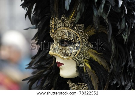 Venetian Carnival Mask - A portrait of one of the most beautiful masks photographed in open street during venetian carnival. - stock photo