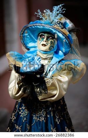 Venetian carnival mask imploring sky (Annecy/France) - stock photo