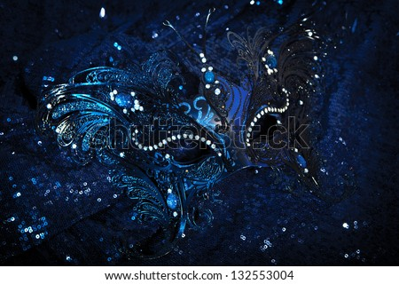 Venetian Carnival Mask on dark  glittering blue background - stock photo