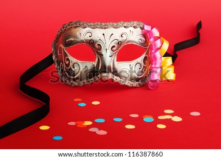 Venetian carnival mask on red - stock photo