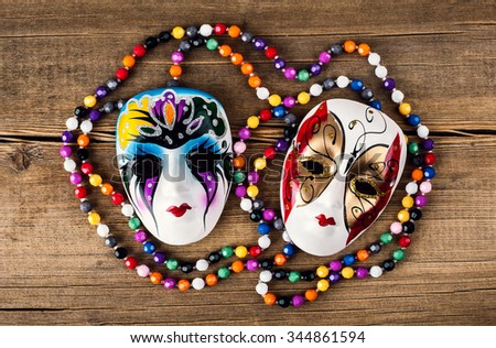 Venetian carnival mask on wooden background - stock photo