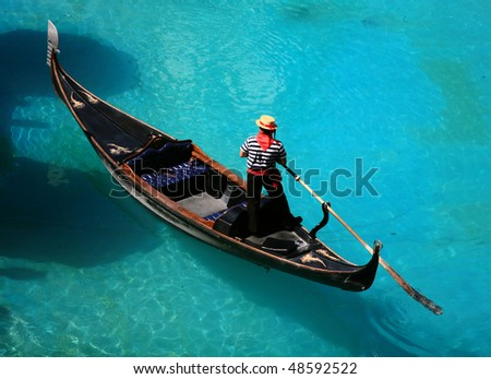 venetian gondola on blue water