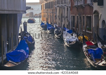 Venetian gondolas in narrow channel, Venice, Italy