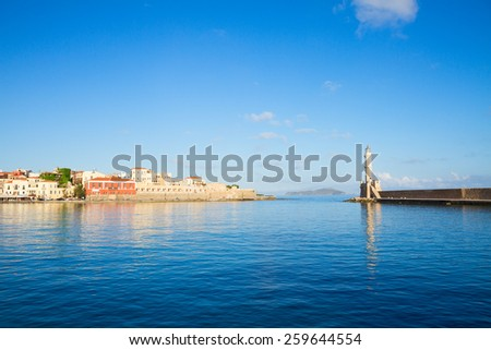 venetian habour of Chania old town with light house at sunny day, Crete, Greece - stock photo