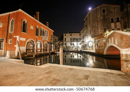 Venetian houses and canal at night in the streets of Venice, Italy - stock photo