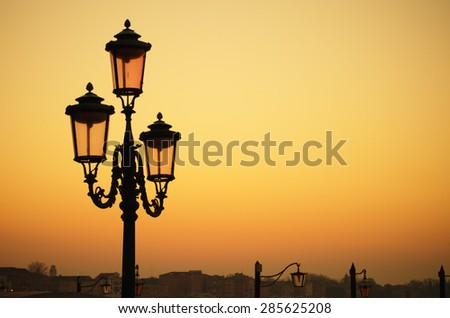 Venetian lamp in the morning - stock photo