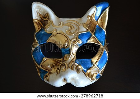 Venetian mask in the form of cat muzzle on dark background