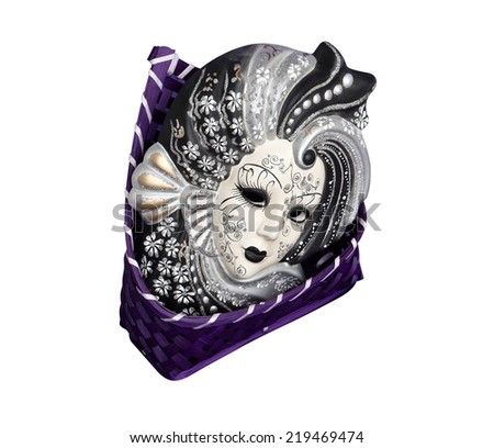 Venetian mask is in the basket isolated on the white background - stock photo