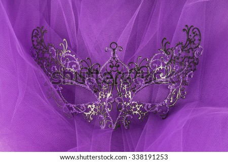 Venetian Mask on Purple Tulle Fabric Background