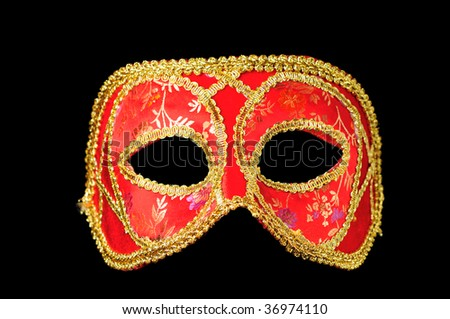 Venetian mask red with gold isolated on black - stock photo