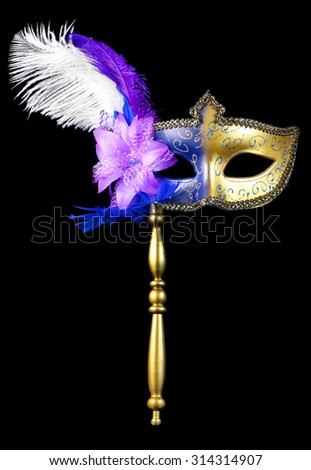 Venetian masquerade or mardi gras mask isolated on a black background