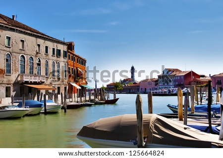 Venetian view with houses and boats in Murano - stock photo
