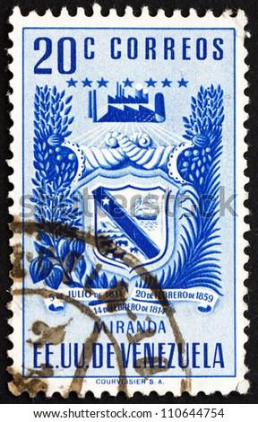 VENEZUELA - CIRCA 1952: a stamp printed in the Venezuela shows Arms of Miranda and Agricultural Products, Venezuela, circa 1952 - stock photo