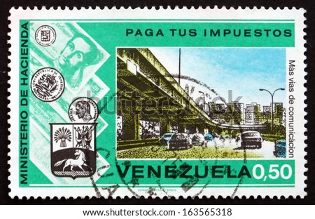 VENEZUELA - CIRCA 1974: a stamp printed in the Venezuela shows Highway and Overpass, Pay Your Taxes Campaign, circa 1974 - stock photo