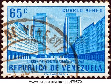"VENEZUELA - CIRCA 1956: A stamp printed in Venezuela from the ""Public Works"" issue shows Simon Bolivar Centre, Caracas, circa 1956. - stock photo"