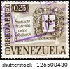 VENEZUELA - CIRCA 1958: A stamp printed in Venezuela issued for the 400th anniversary of Santiago de Merida de los Caballeros shows Arms of Santiago de Merida, circa 1958. - stock photo